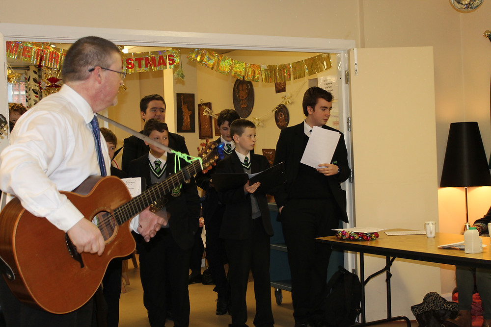 Mr Dowd leading the Folk Group in song