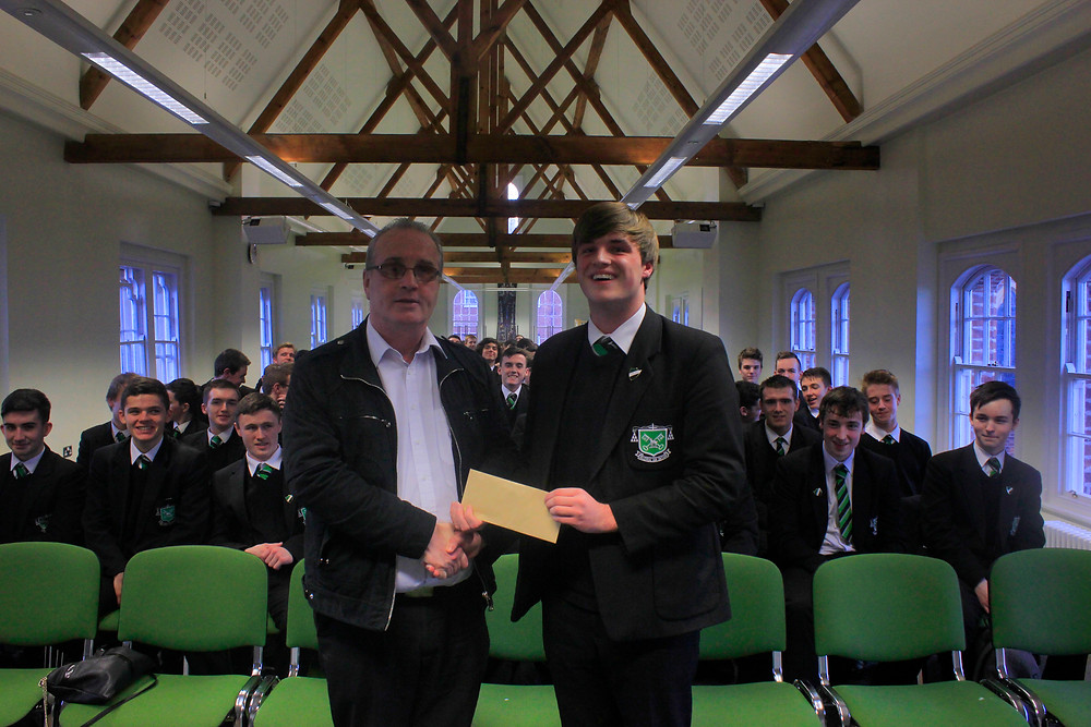 Head_Boy,_James_Cunningham_presents_Mr_Moore_with_a_cheque_for_£100.JPG