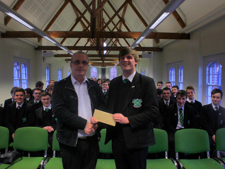 Year 14 make a donation to the charity 'Children in Crossfire'