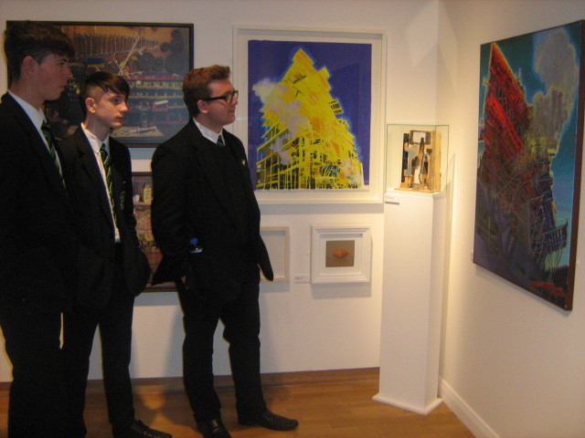 Year 13 and 14 students admiring the art work by former pupil Simon McWilliams