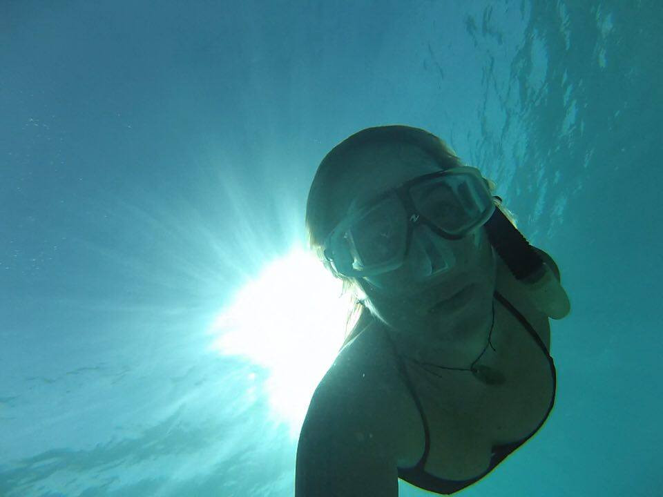 Louisa Collyns swimming underwater in Formentera