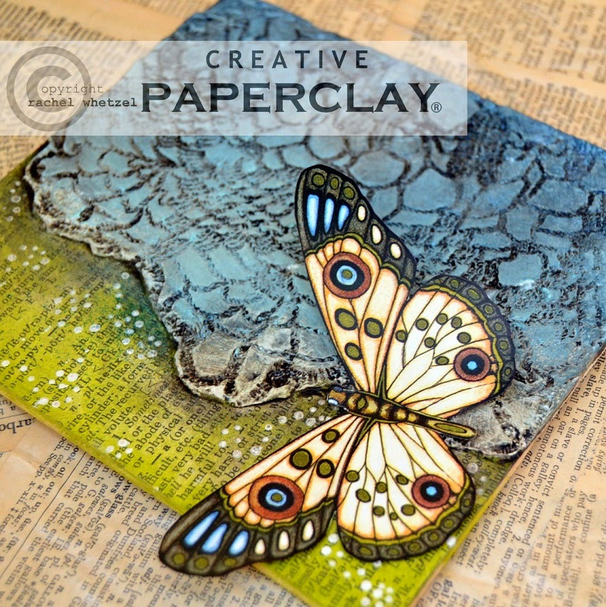Picture of an example of some clay and paint on a canvas, and how Creative Paperclay did it