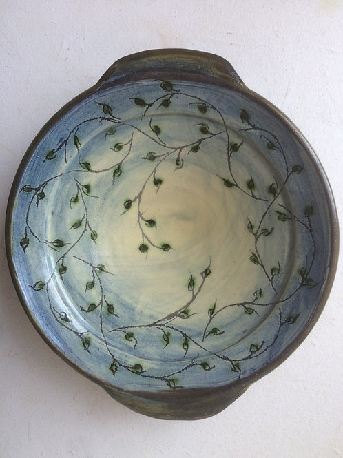 Shallow slipware dish with lugs