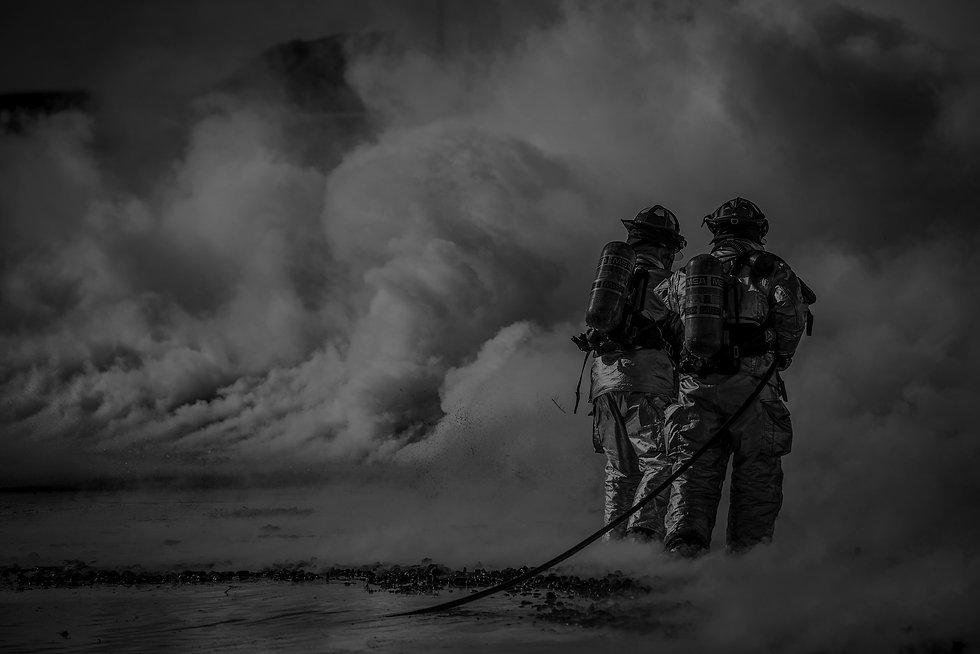 Canva---Firefighter-Standing-Beside-Smok