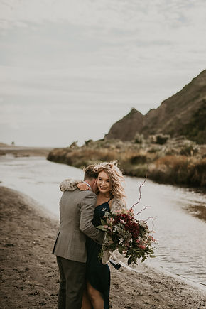 couple, auckland photographer, wedding photography, bethell's beach, lovers, navy dress