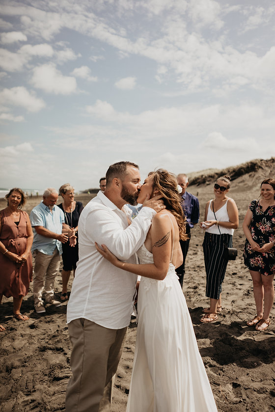 Small wedding on west coast beach in Auckland by wanderlusting lovers