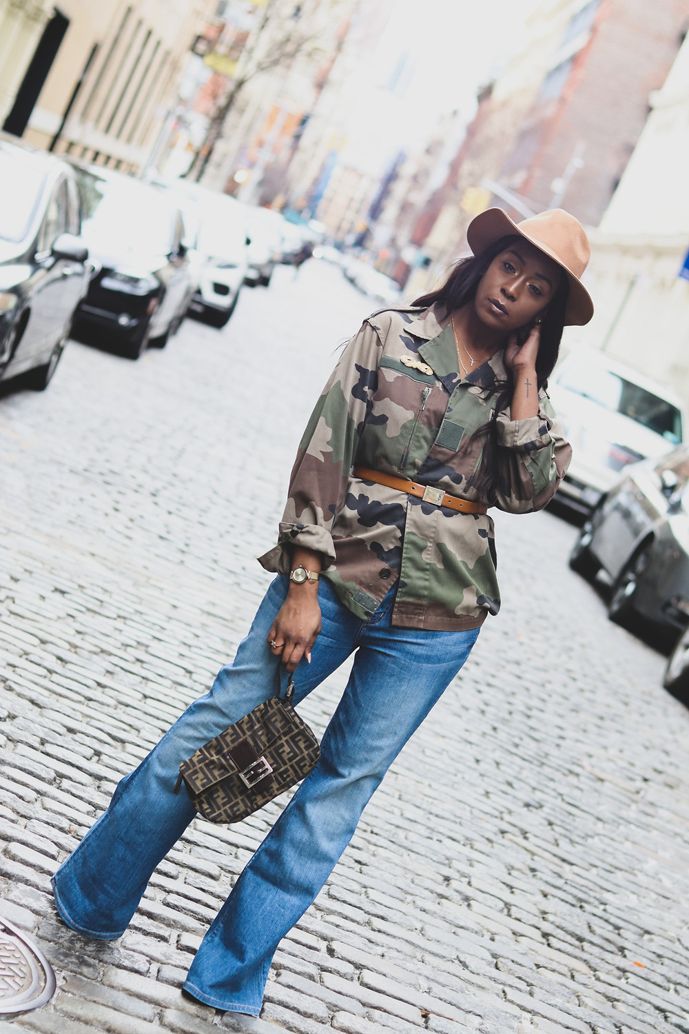 pre-loved fashion, camo jacket, flare denim, fendi bag, fedora,ysl beltpre-loved fashion, camo jacket, flare denim, fendi bag, fedora,ysl beltFendi zuuca baguette (The Real Real), Christian Dior brooch (The real real), YSL belt ,soho ,nyc, fashion, fashion photography.