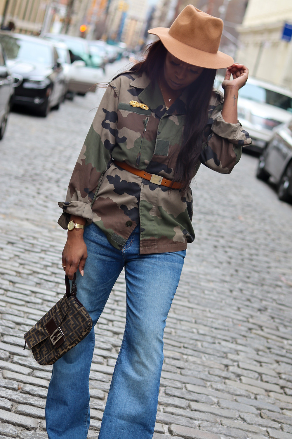 pre-loved fashion, camo jacket, flare denim, fendi bag, fedora,ysl beltFendi zuuca baguette (The Real Real), Christian Dior brooch (The real real), YSL belt ,soho ,nyc, fashion, fashion photography.