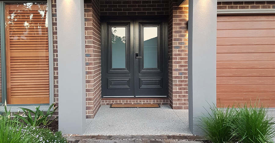 Inviting double doors lead to the house
