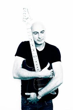 Alex Cortiz loves his guitar
