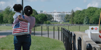 A visitor to the White House in Washington DC and her child.