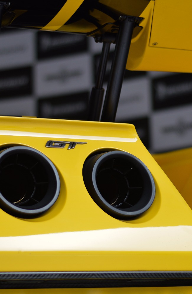 Twin exhaust pipes sit centrally below the small adjustable wing