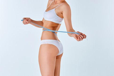 woman-holding-meter-measuring-perfect-sh