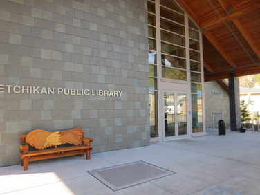 Ketchikan Public Library - front view with Larry Jackson bench