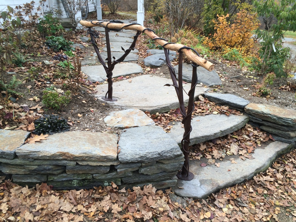 Wooden branch railing w/ vine wrap
