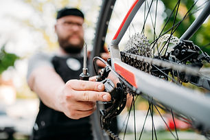 bicycle-mechanic-repair-bike-with-broken