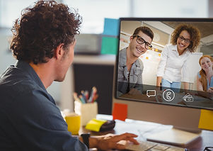 Man having video call with colleagues on