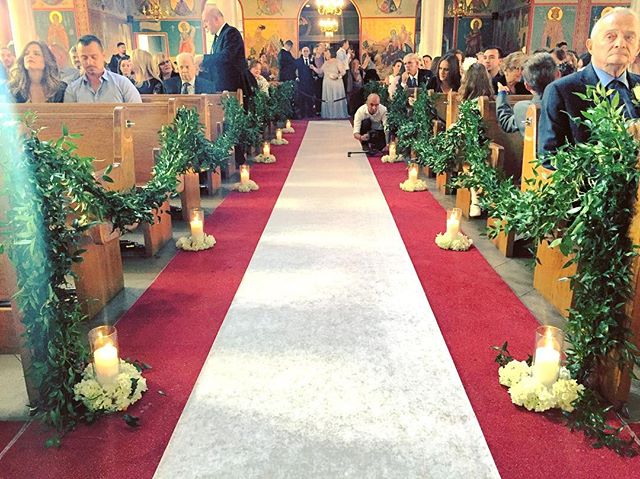 Garland on the pews, candles and hydrangeas coming together nicely