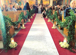 Garland on the pews, candles and hydrang