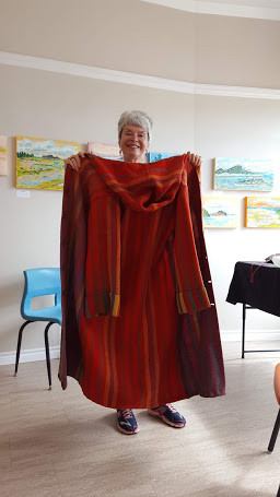 Violet showcasing her textile art at Round Hill Studio, Annapolis Royal
