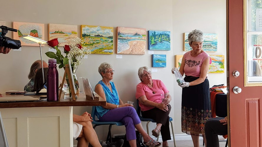Violet explaining her process to an audience at Round Hill Studio, Annapolis Royal