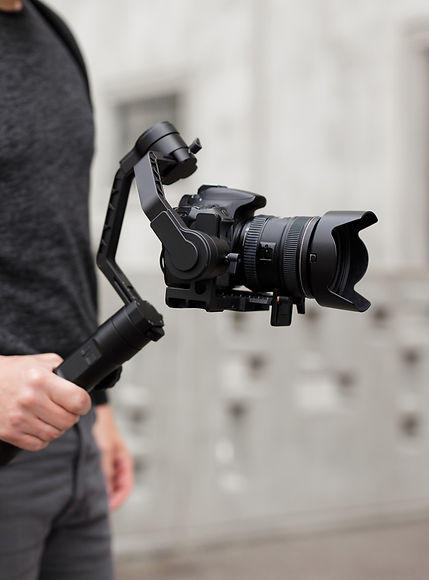 videography, filmmaking and creativity concept - close up of modern dslr camera on 3-axis