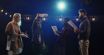 Medium shot of actors and actresses arguing during rehearsal in a theater.jpg