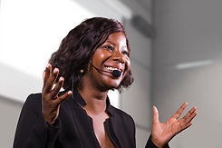 young attractive and confident black African American business woman with headset speaking