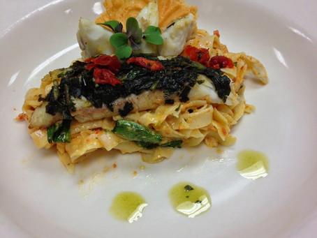 Horn Island Flounder Capresse over Fresh Fettuccine Pasta in a Sun - Dried Tomato Cream Sauce