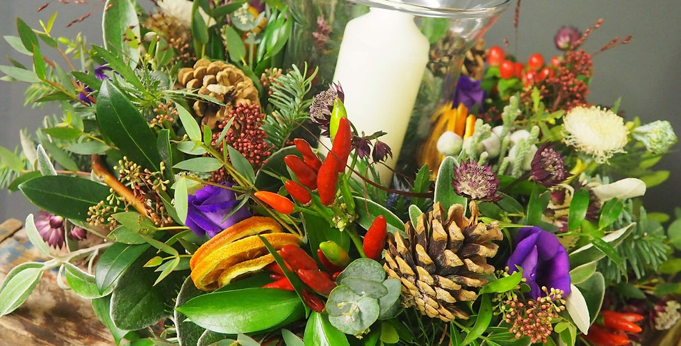 Wild Christmas Table Arrangement with Candle in Vase