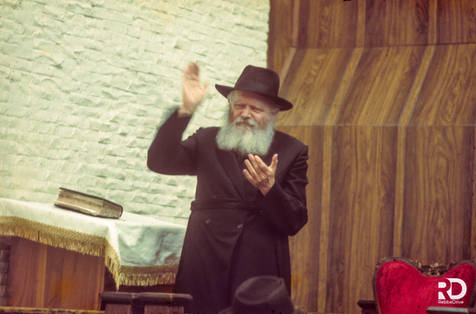 The Rebbe encourages the children's singing