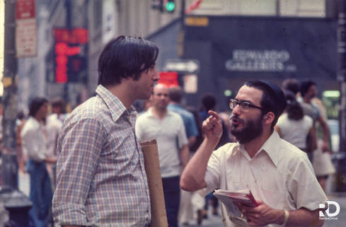 Yeshiva students on the streets of Manhattan encouraging passerby to perform mitzvot and good deeds