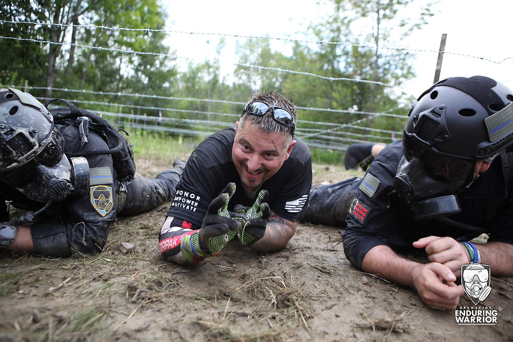 OEW athletes doing barbed wire crawl at Spartan Race.