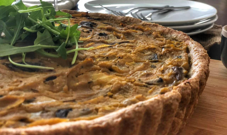 Pumpkin tart with caramelized onions and