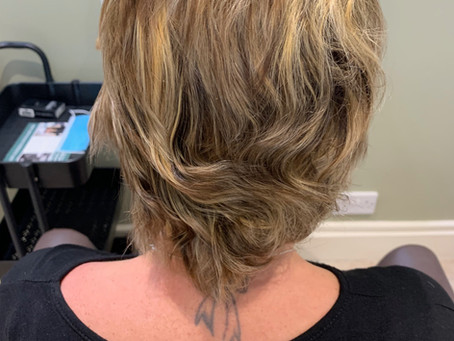What does having a non surgical hair replacement system involve?