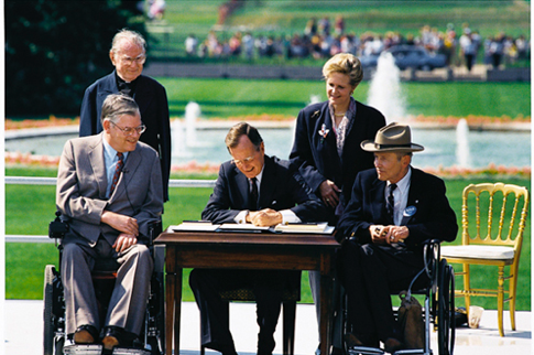 President George Bush Sr. on the White House Lawn signing the Americans with Disabilities Act in 1990