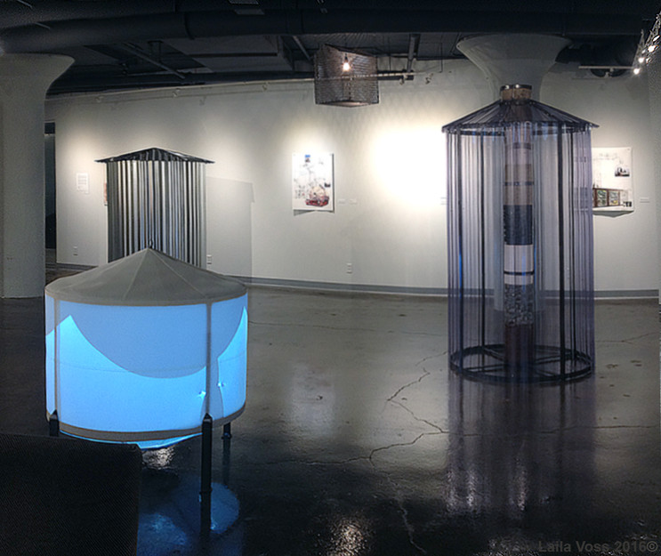 """Video Hopper.     RPM Silo. 2016. Corrugated steel, motor, audio. 5.5' x 3.5' D.     Transforming Station. 2016. Expanded steel, electrical components. 23.5"""" x 22"""" x 17"""".    Core Sample Silo.     Drawings in background- see Works on Paper."""