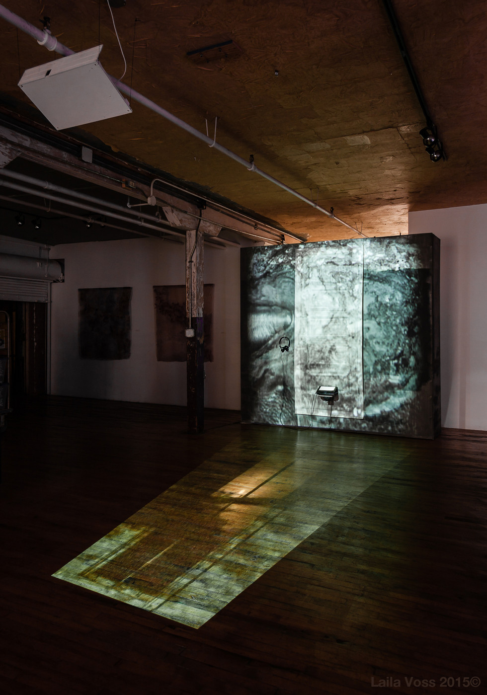 Searching for that Sound Piece. 2010- 2015. Installation view with video projections of a window and graphite hands. Photo credit: Jerry Mann.