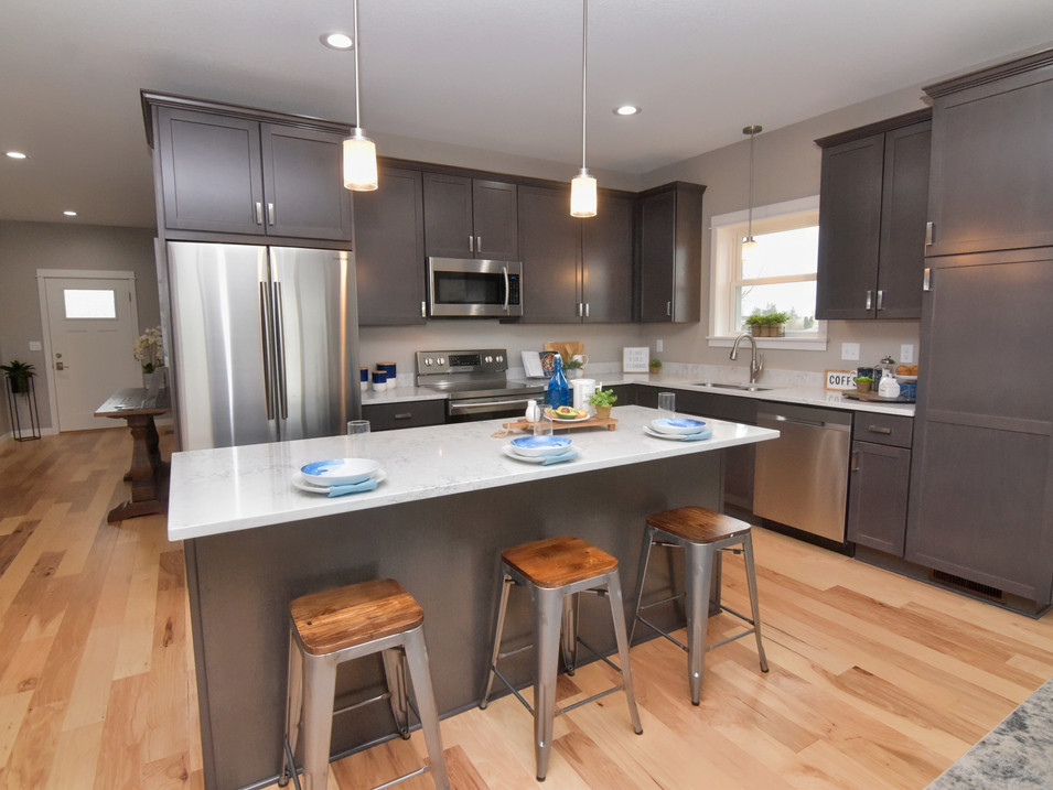 staged kitchen in custom builders home