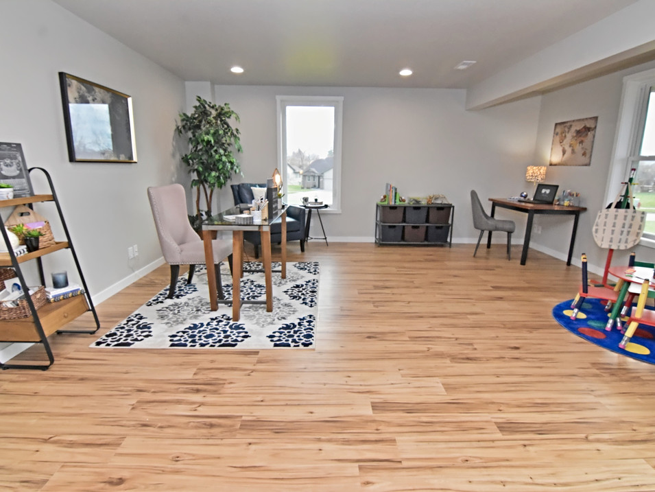 staged walk out basement dual office space in custom builders home