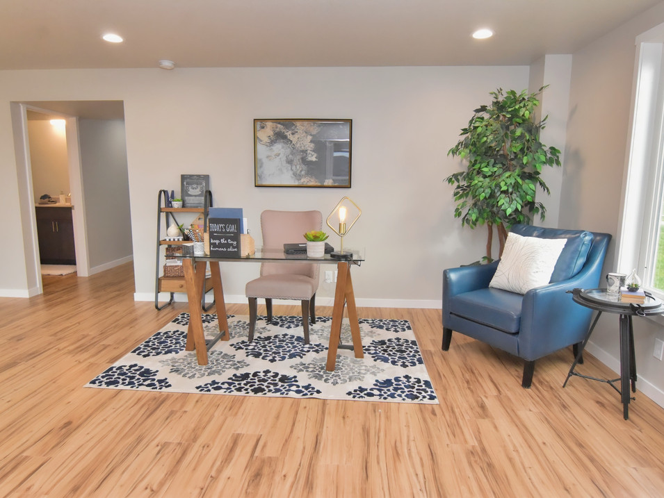 staged walk out basement home office area in custom builders home
