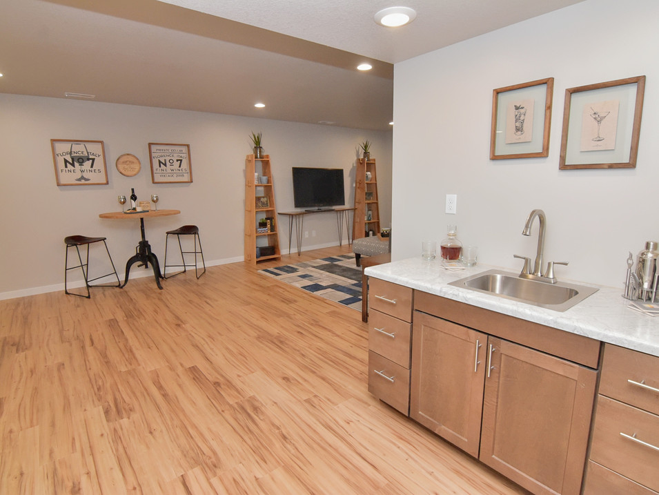 staged walk out basement bar area in custom builders home