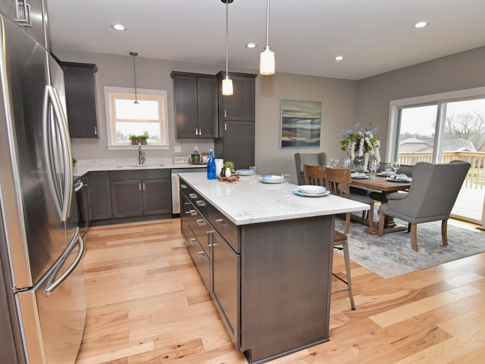 staged dining/kitchen in custom builders home