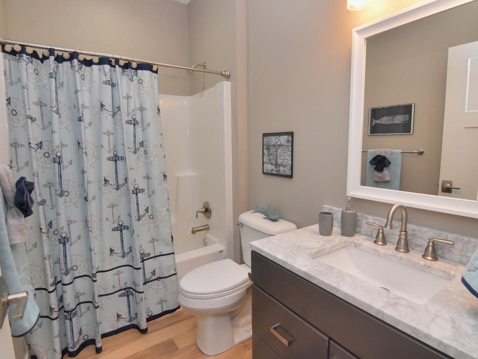staged kid's bathroom in custom builders home