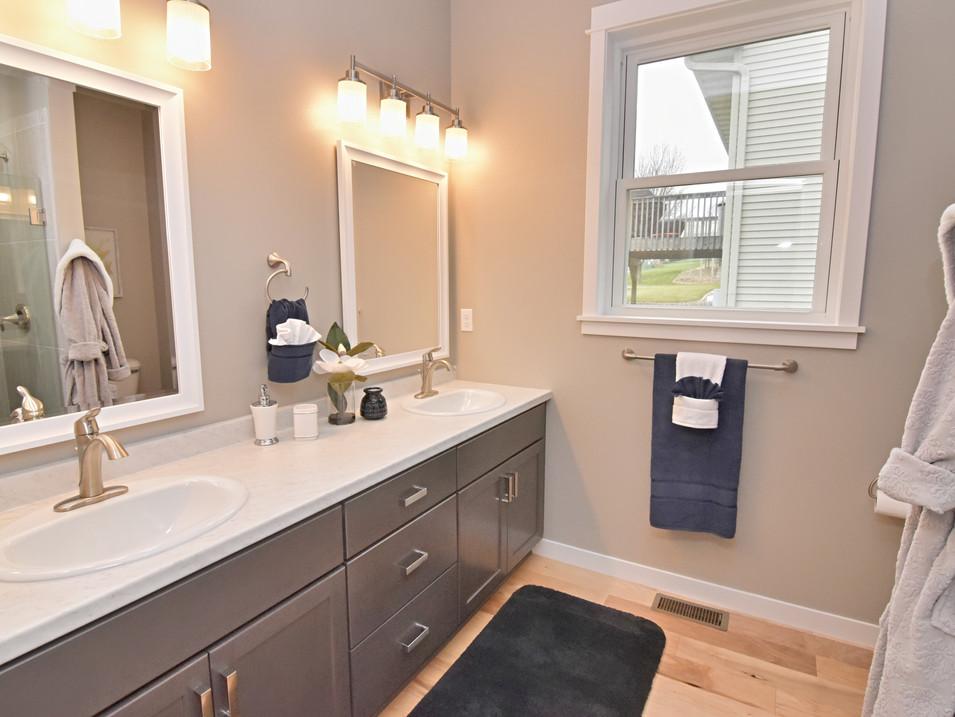 staged main bathroom suite in custom builders home