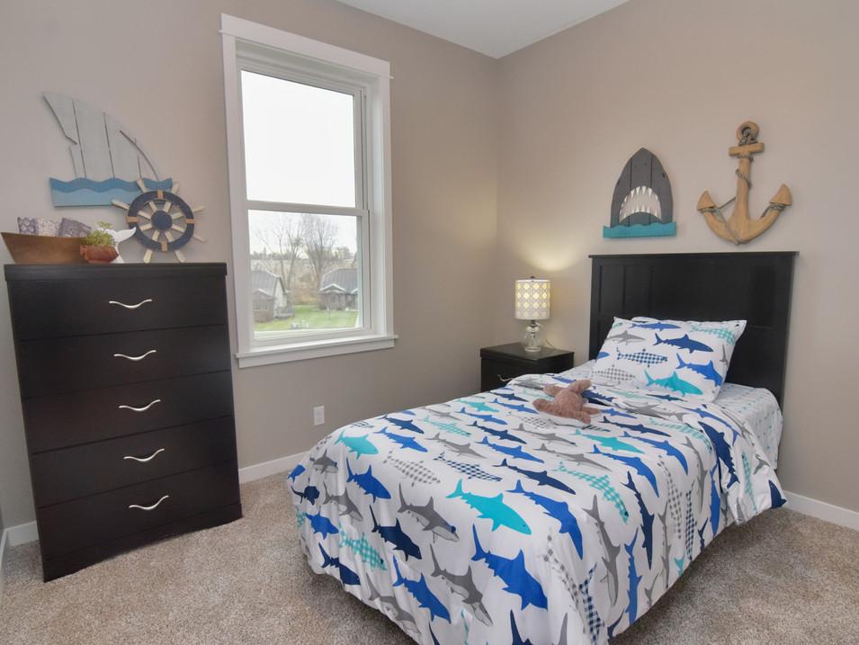 staged kid's bedroom in custom builders home