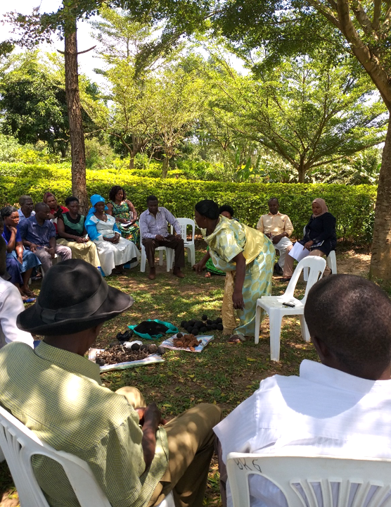 A member of Kasuubi Zone III Women's' group demonstrating their process plan. (Photo credit: Teddy Kisembo)