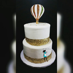Golden balloon baby shower cake.
