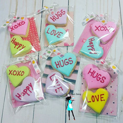 Mini Conversation heart cookies all packaged and ready for delivery tomorrow!