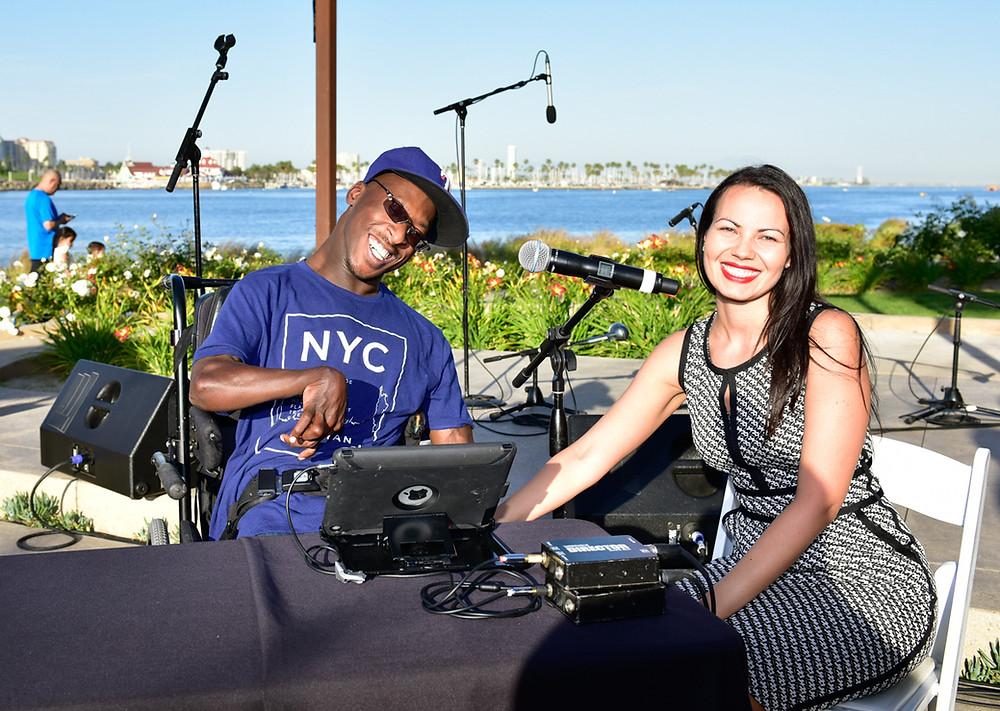 DJ PJ and OTA Stephanie pose with music equipment
